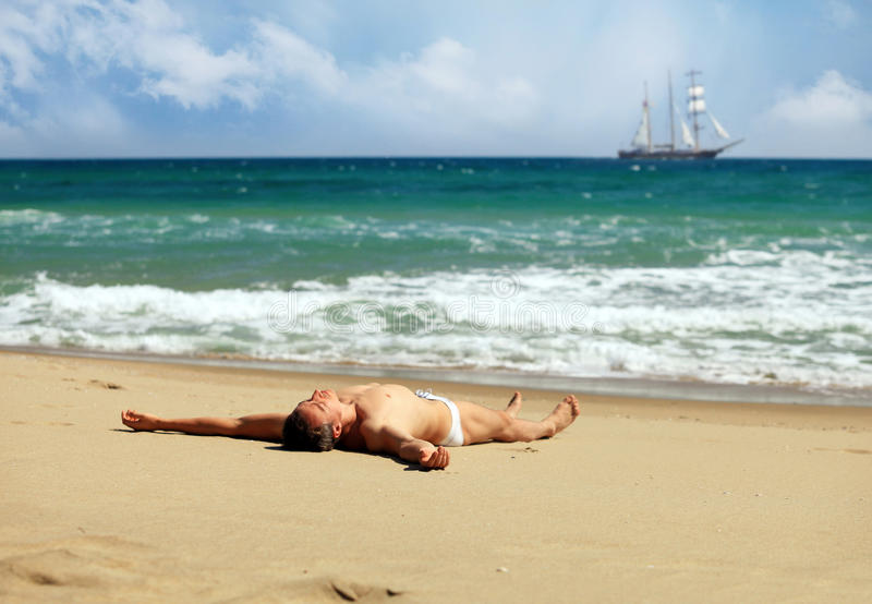 Download Young Man Sunbathing At A Beach Stock Image - Image: 24843123