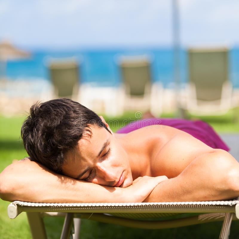 Download Young Man Sunbathing And Relaxing On A Deckchair Stock Image - Image: 25387391
