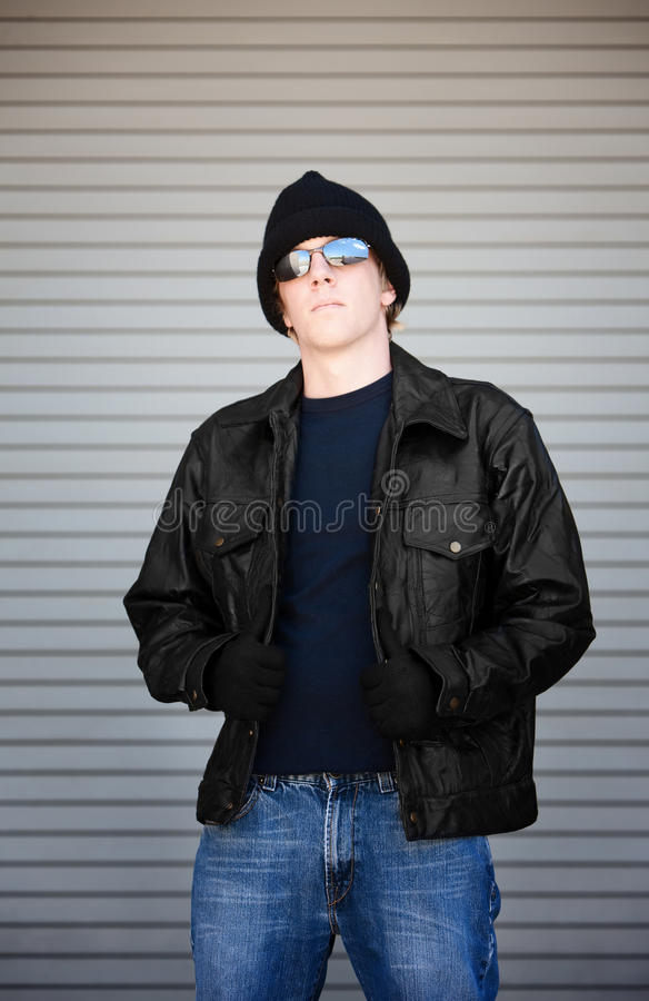 Young man in sunglasses stock photography