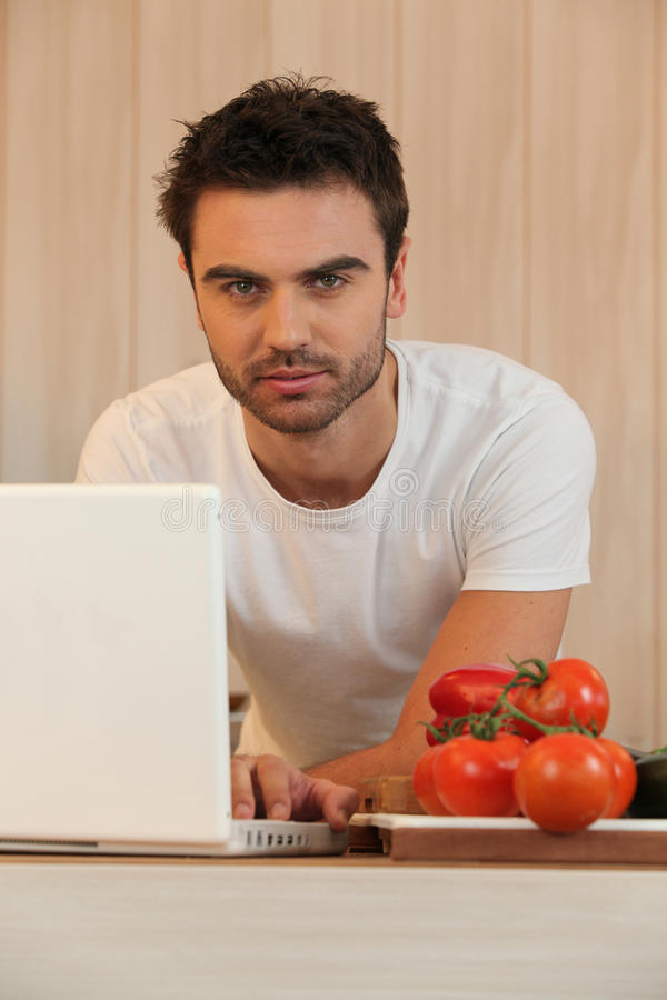 Young Man Surfing The Internet Stock Image