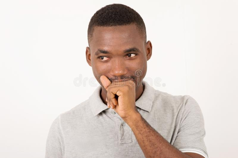 Young man surprised and holding his mouth by the hand stock photos