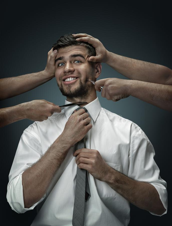 A young man surrounded by hands like his own thoughts stock images