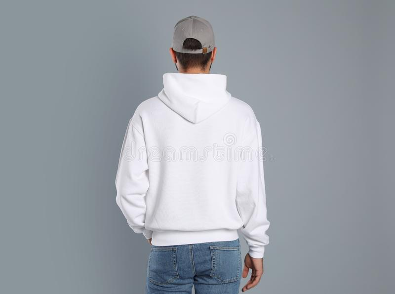 Young man in sweater on background. Mock up for design stock photos