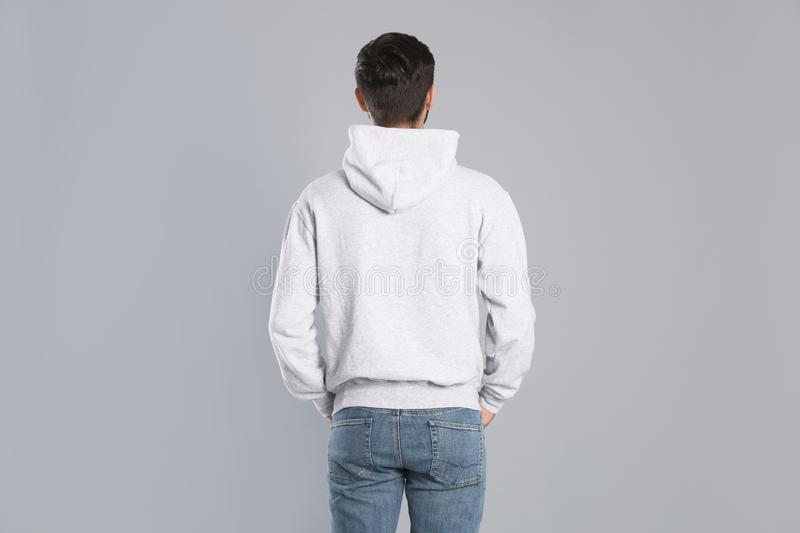 Young man in sweater on background. Mock up for design royalty free stock photos