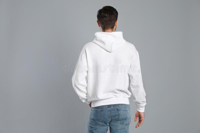 Young man in sweater on grey background royalty free stock photos