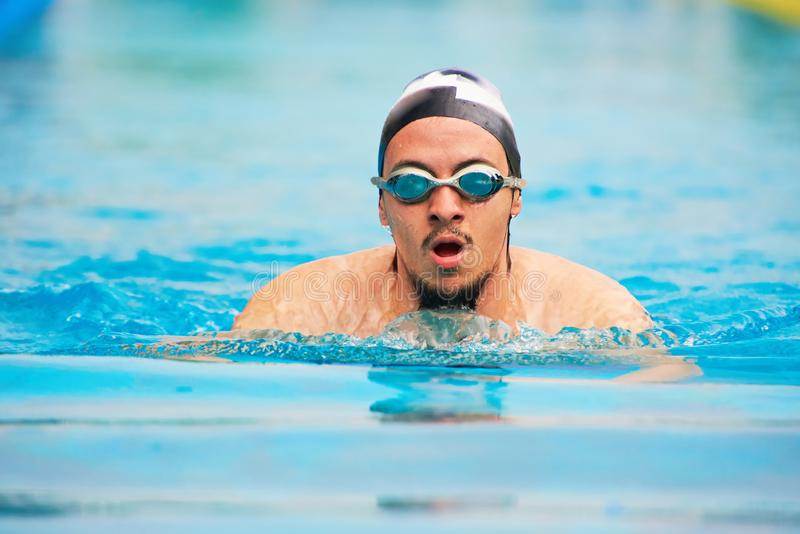 Young man swimmer stock photo