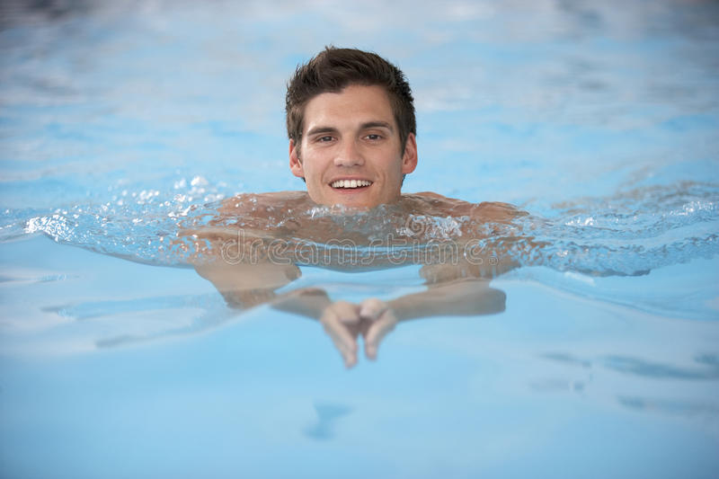 Download Young Man Swimming In Pool stock image. Image of people - 9388547