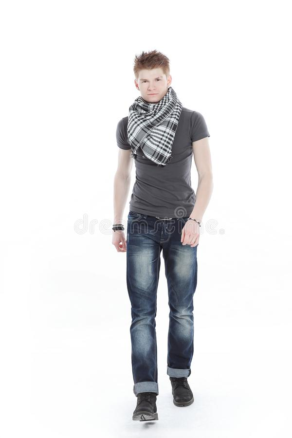 Young man in a t-shirt and scarf ,confidently goes forward. royalty free stock photos