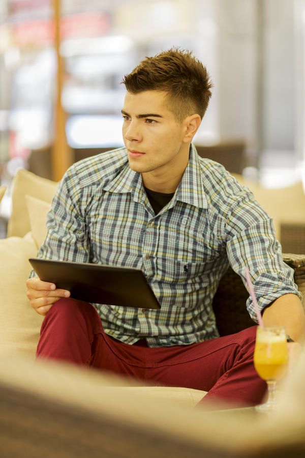 Download Young man with tablet stock image. Image of handsome - 33577589