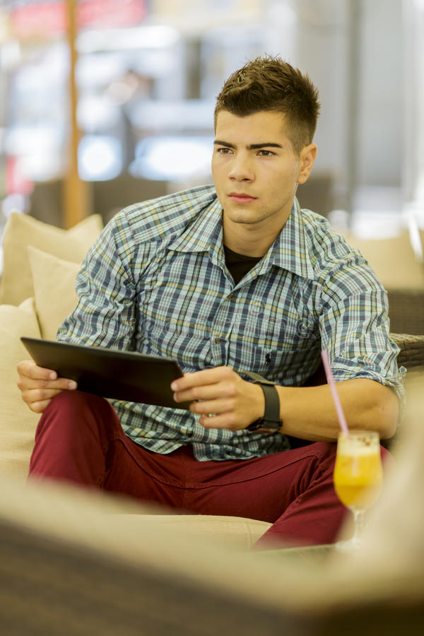 Download Young man with tablet stock image. Image of casual, male - 33760637