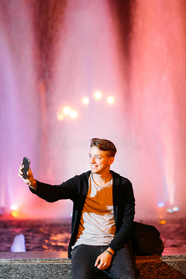 Young man take selfie on smartphone in city royalty free stock image