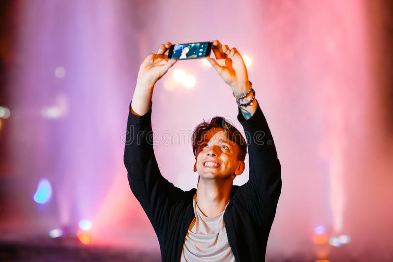 Young man take selfie on smartphone in city royalty free stock images