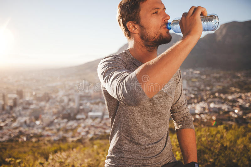 Young man taking a break after morning run royalty free stock image