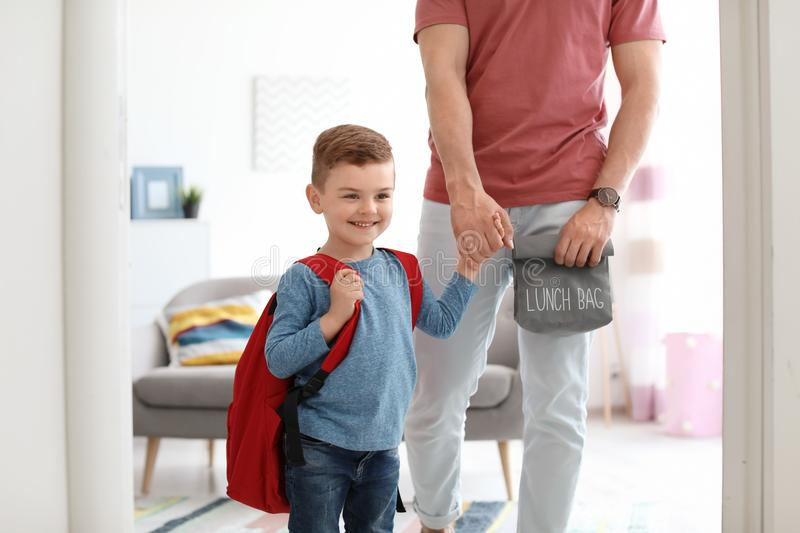 Young man taking his little child. Young men taking his little child to school royalty free stock photography