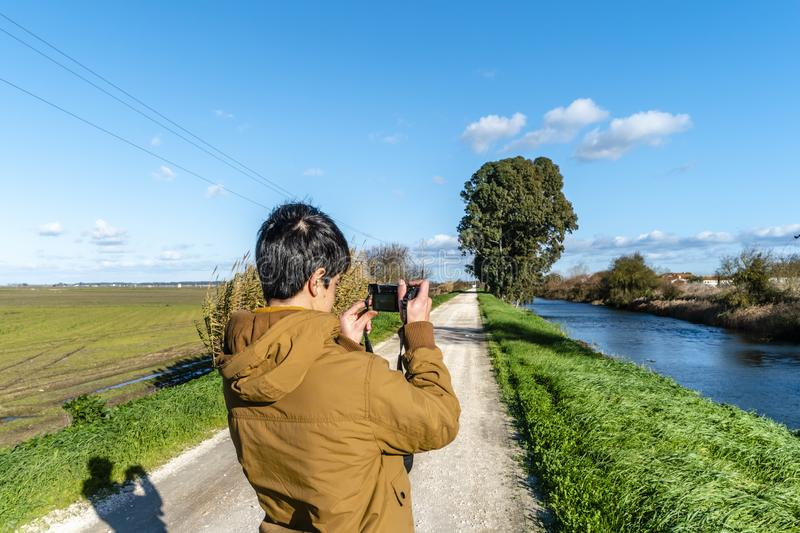 Young man taking picture on natural background.  stock images