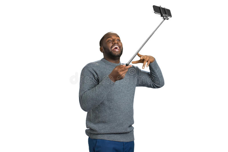 Young man taking selfie picture in studio. royalty free stock photos