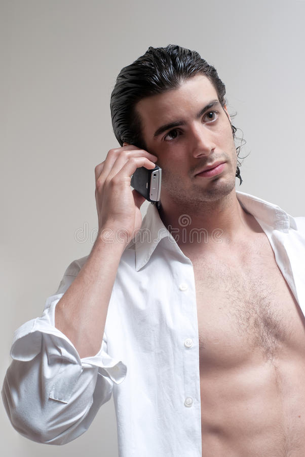 Young man talking on cell phone stock photography