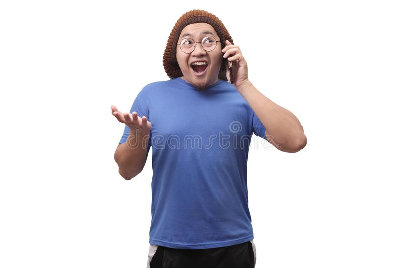 Young Man Talking on his Phone, Happy Smiling Laughing stock photography