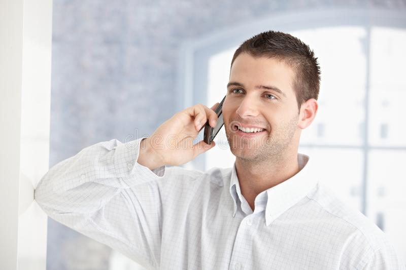 Download Young Man Talking On Mobile Phone Smiling Stock Image - Image: 18382335