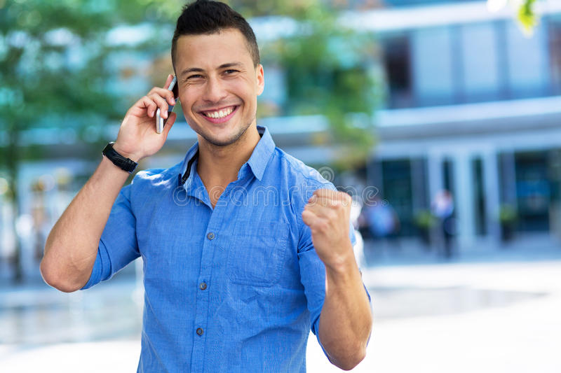 Young man talking on smartphone stock photo
