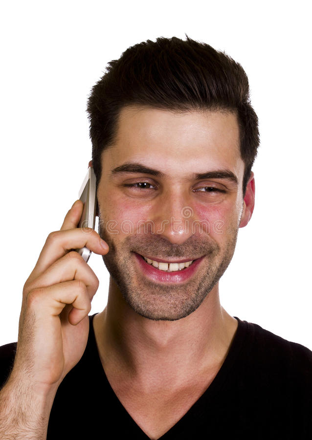 Young man is talking on the telephone stock image
