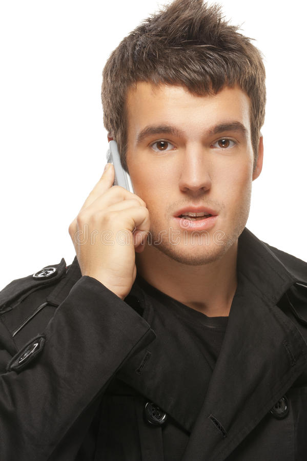Download Young Man Talks By Mobile Phone Royalty Free Stock Photography - Image: 33502917