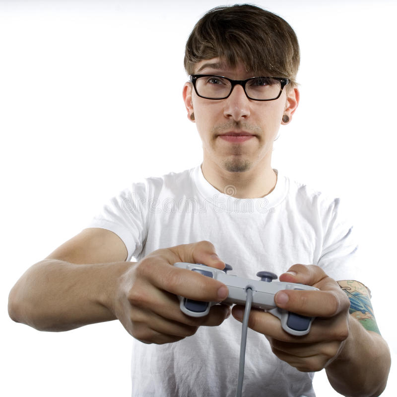 Young man with tattoos playing video games royalty free stock photo