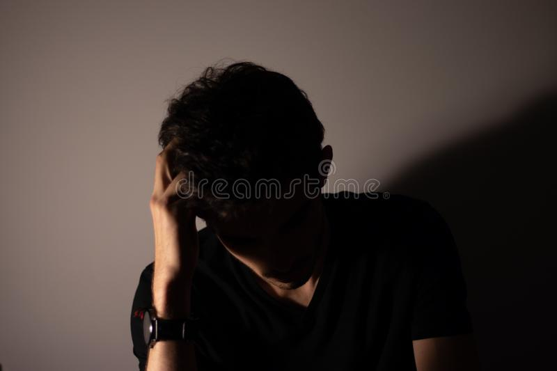 Young man teenager silhouette waiting black stock photo