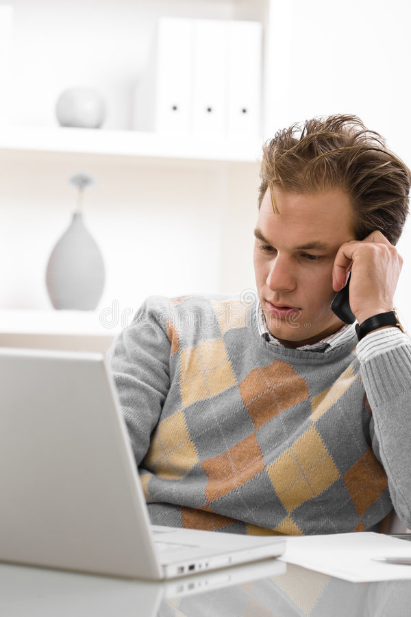 Young man teleworking stock images