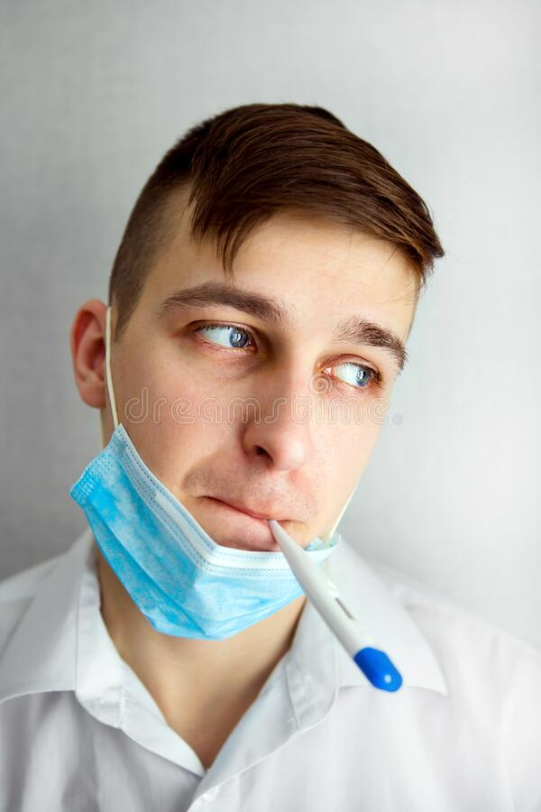 Young Man with a Thermometer stock image