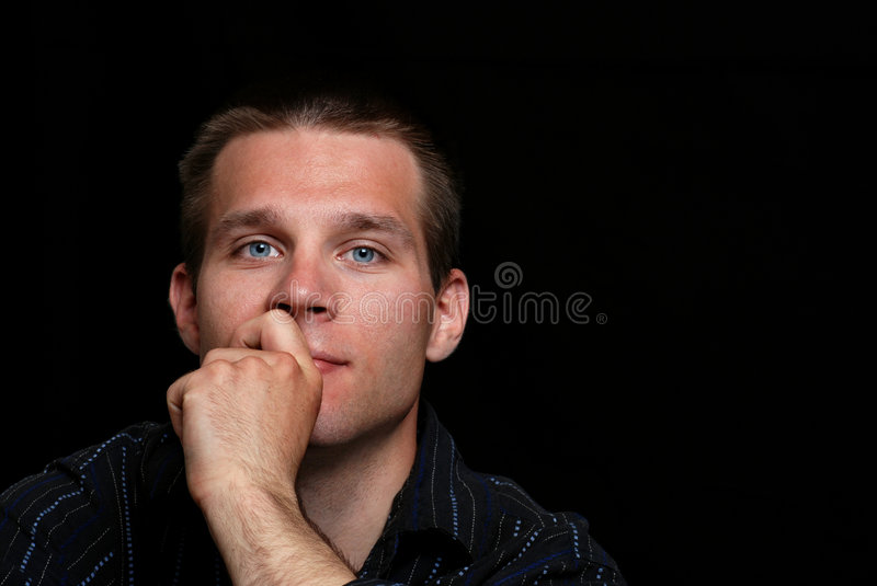 Young man thinking stock photo