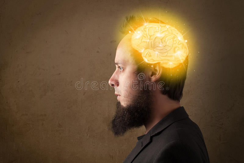 Young man thinking with glowing brain illustration. Man thinking with glowing brain illustration stock images