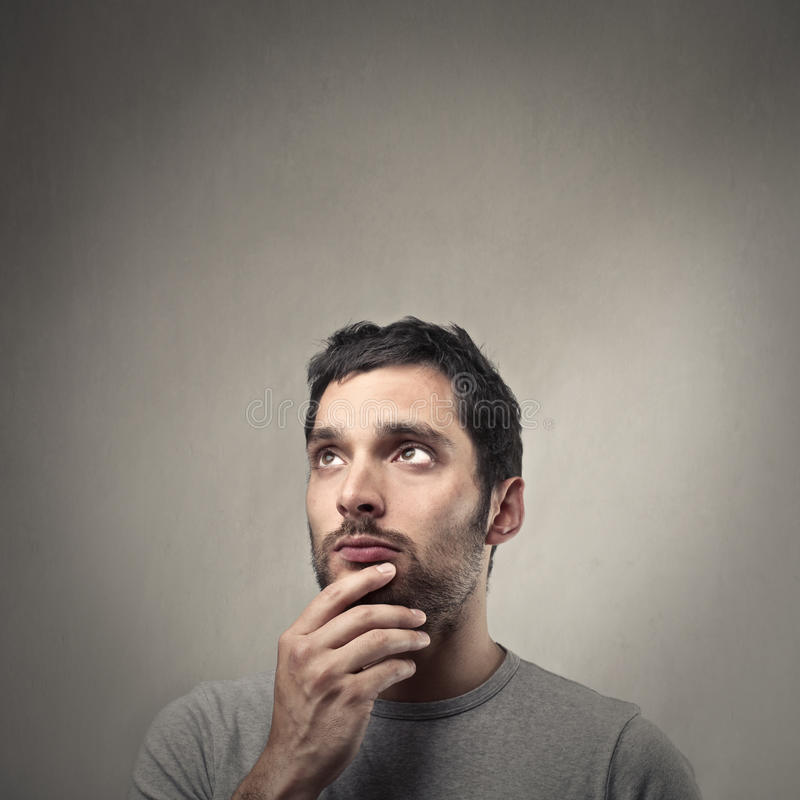 Young man thinking stock image