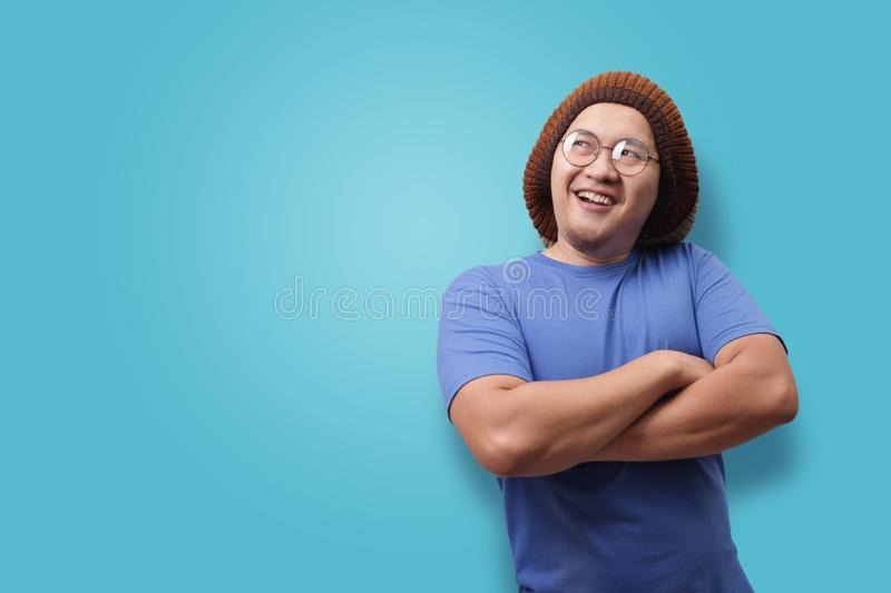 Young Man Thinking and Looking Up, Having Good Idea stock image
