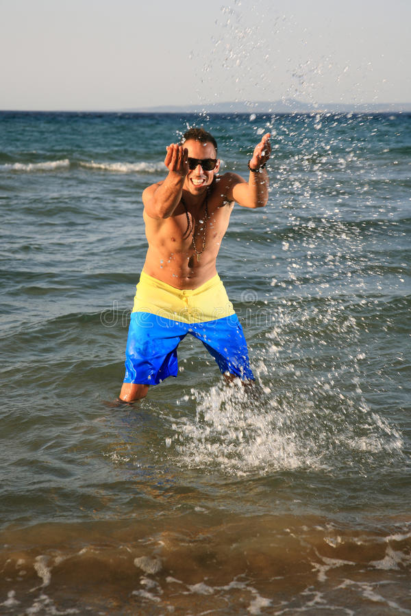 Young Man Throwing Water Royalty Free Stock Images