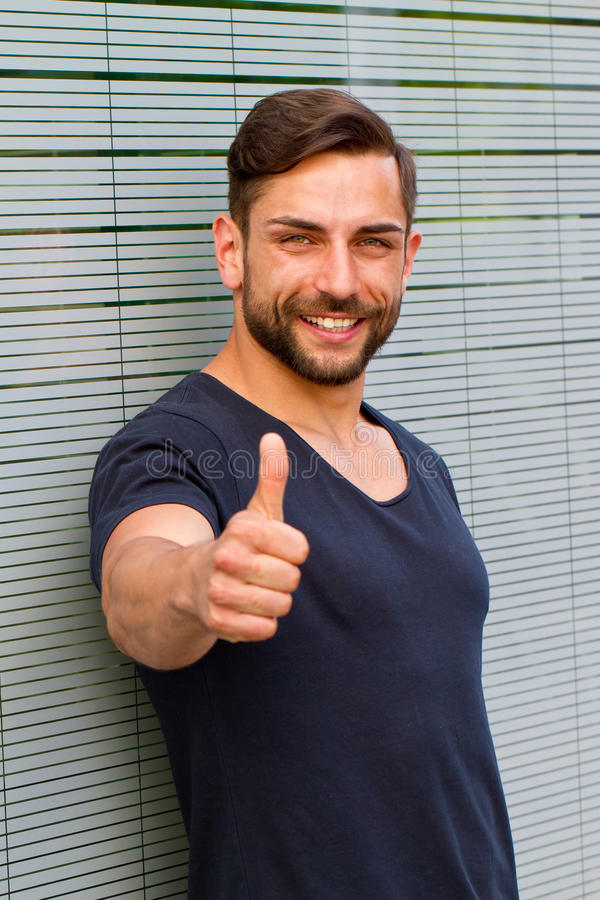 Young man with thumb up royalty free stock image