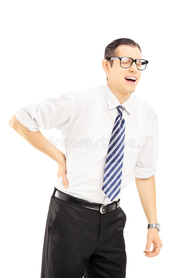 Young man with tie suffering from a back pain. Isolated on white background stock photos
