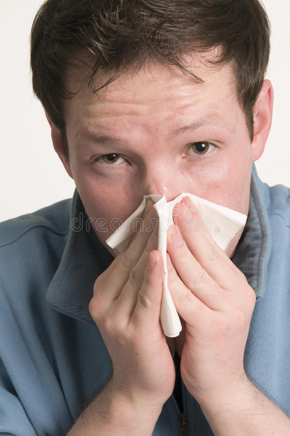 Young man with tissue stock image