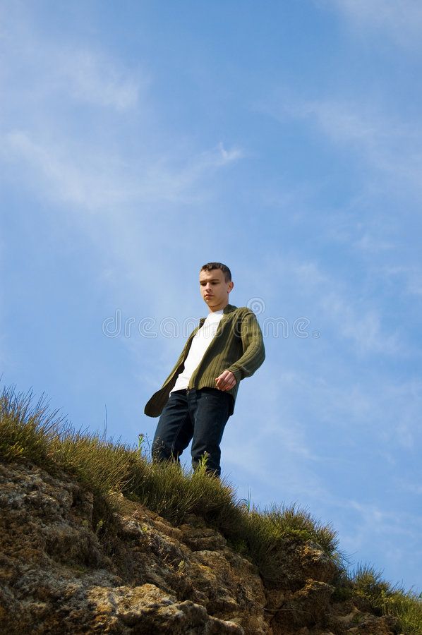A Young Man On The Top Of The Cliff Stock Photo