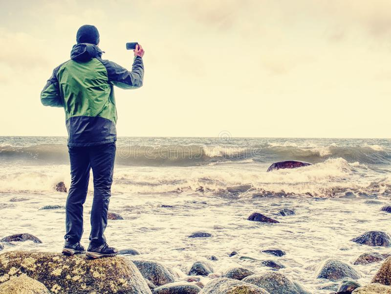 Young man with touristic suit looking on amazing seascape stock image