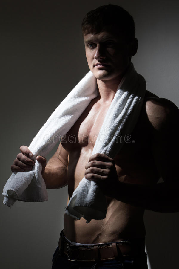 Young man with towel over his neck stock photo