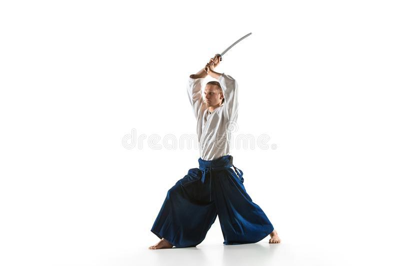 The young man are training Aikido at studio. The young man are training in Aikido at studio with saber.Aikido master practices defense posture. Healthy lifestyle stock images