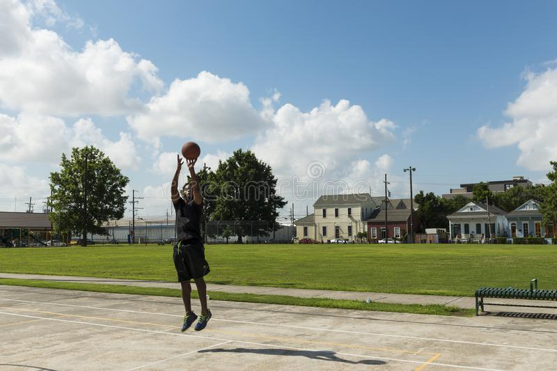 Young man training basketball in a street court in the city of New Orleans, Louisiana stock images