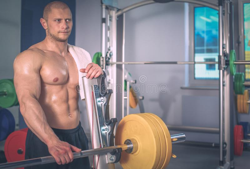 Young man training at gym with exercises . Young man royalty free stock photography