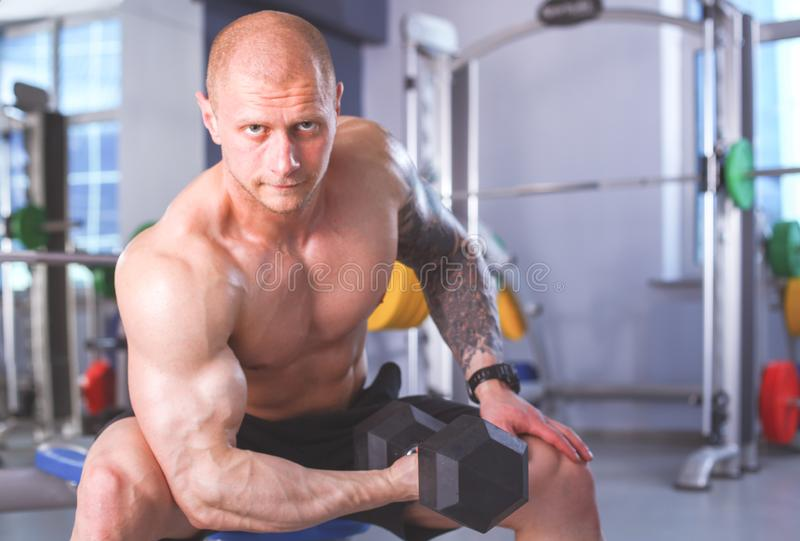 Young man training at gym with exercises . Young man royalty free stock image