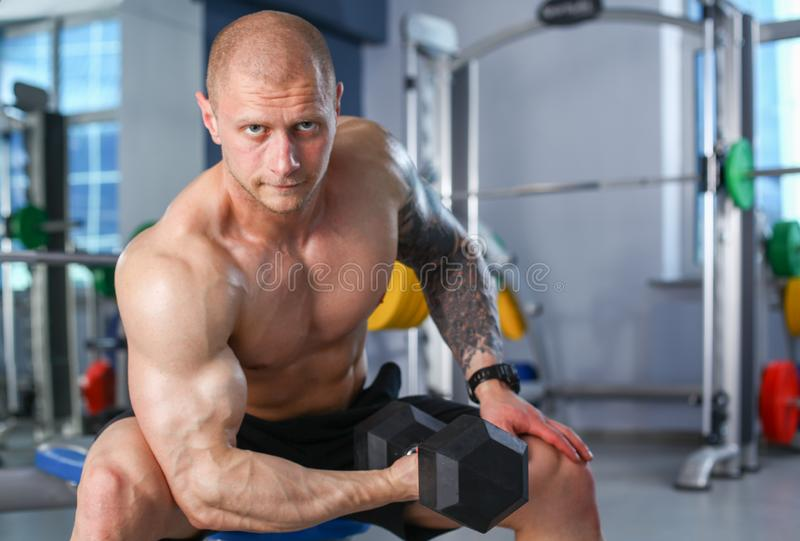 Young man training at gym with exercises . Young man stock images