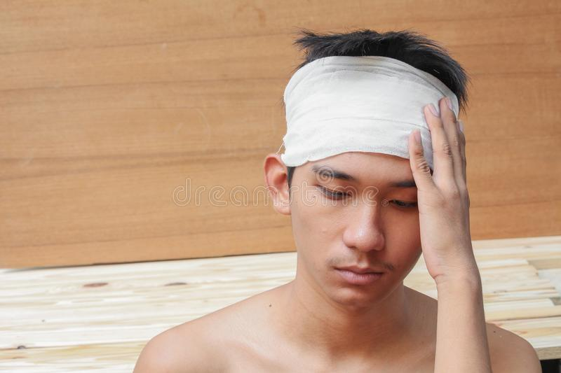 Young man with trauma of the head. by Medical bandage. Portrait show royalty free stock images