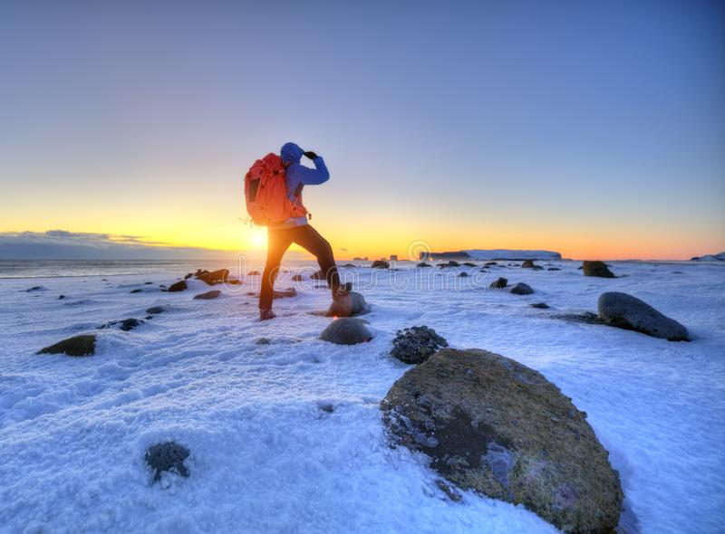 Young man traveler with backpack, Iceland royalty free stock photo