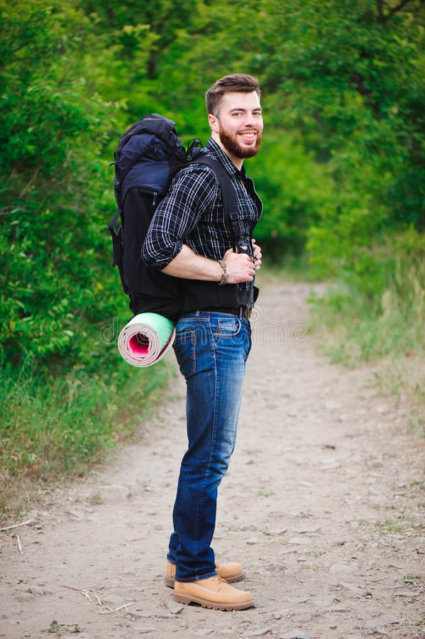 Young Man Traveler with backpack relaxing outdoor. Summer vacations and Lifestyle hiking concept. stock images