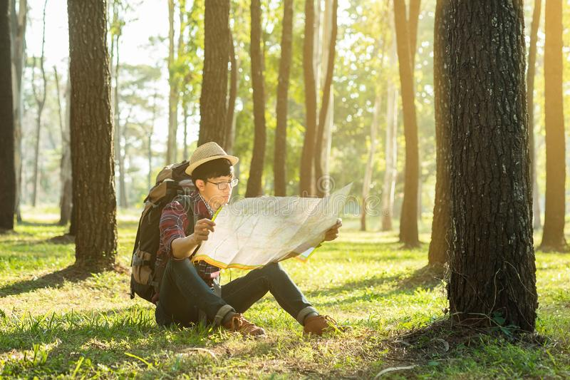 Young Man Traveler with backpack, Viewing map relaxing outdoor o stock photos